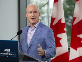 Conservative Leader Erin O'Toole speaks to the media, Aug. 18, 2021, in Quebec City.